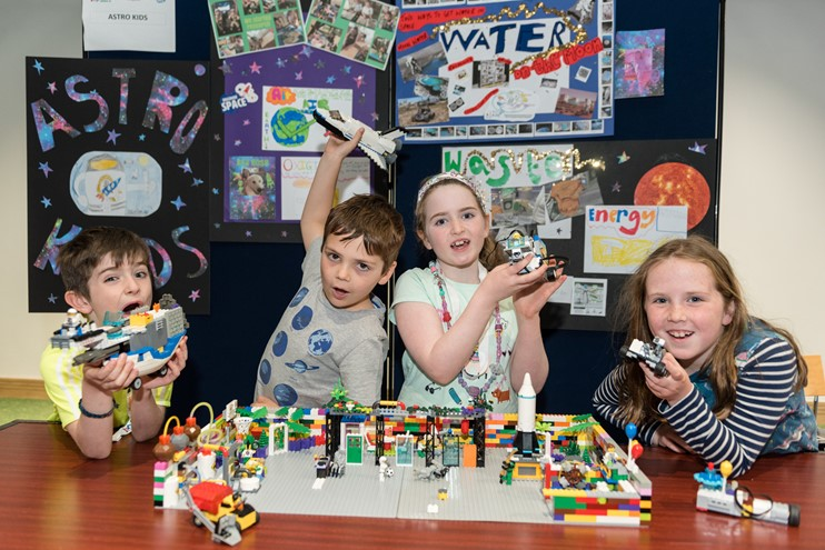 Astro Kids displaying their LEGO creations
